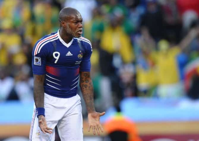 France's striker Djibril Cisse reacts during the Group A first round 2010 World Cup football match France vs. South Africa on June 22, 2010 at Free State Stadium in Mangaung/Bloemfontein .NO PUSH TO MOBILE / MOBILE USE SOLELY WITHIN EDITORIAL ARTICLE - AFP PHOTO / VINCENZO PINTO