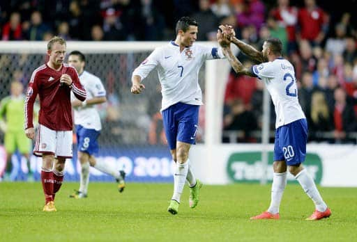 Portugal's Cristiano Ronaldo jubelt beim Spiel Dänemark gegen Portugal in Kopenhagenam 14.Oktober 2014. (AFP PHOTO / SCANPIX DENMARK / LISELOTTE SABROE/)