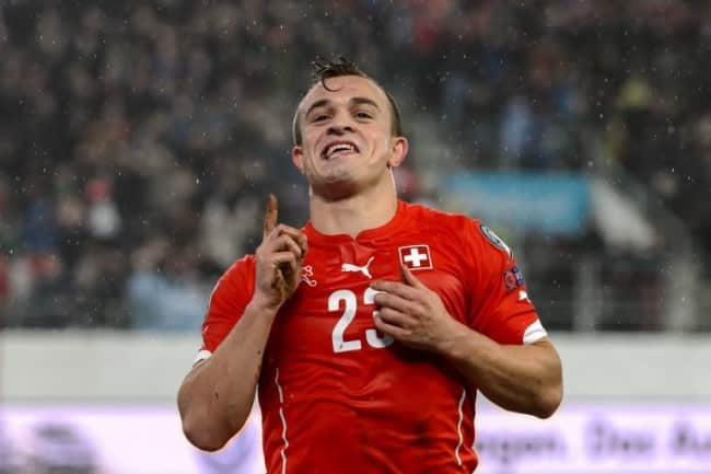 Switzerland's midfielder Xherdan Shaqiri celebrates after scoring the team's third goal during an Euro 2016 Group E qualifying match Switzerland against Lithuania at the AFG Arena on November 15, 2014 in St Gallen. AFP PHOTO / FABRICE COFFRINI